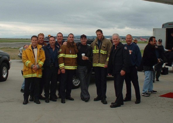 Neil Diamond and the Vancouver, BC Firefighters.  Photo by Stuart Corrigal, Fire Captain